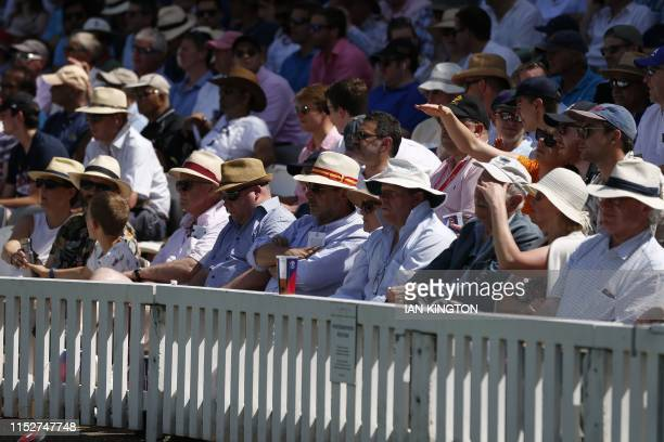 Spectators enjoy the 2019 Cricket World Cup group stage match between New Zealand and Australia at Lord's Cricket Ground in London on June 29 2019 /...