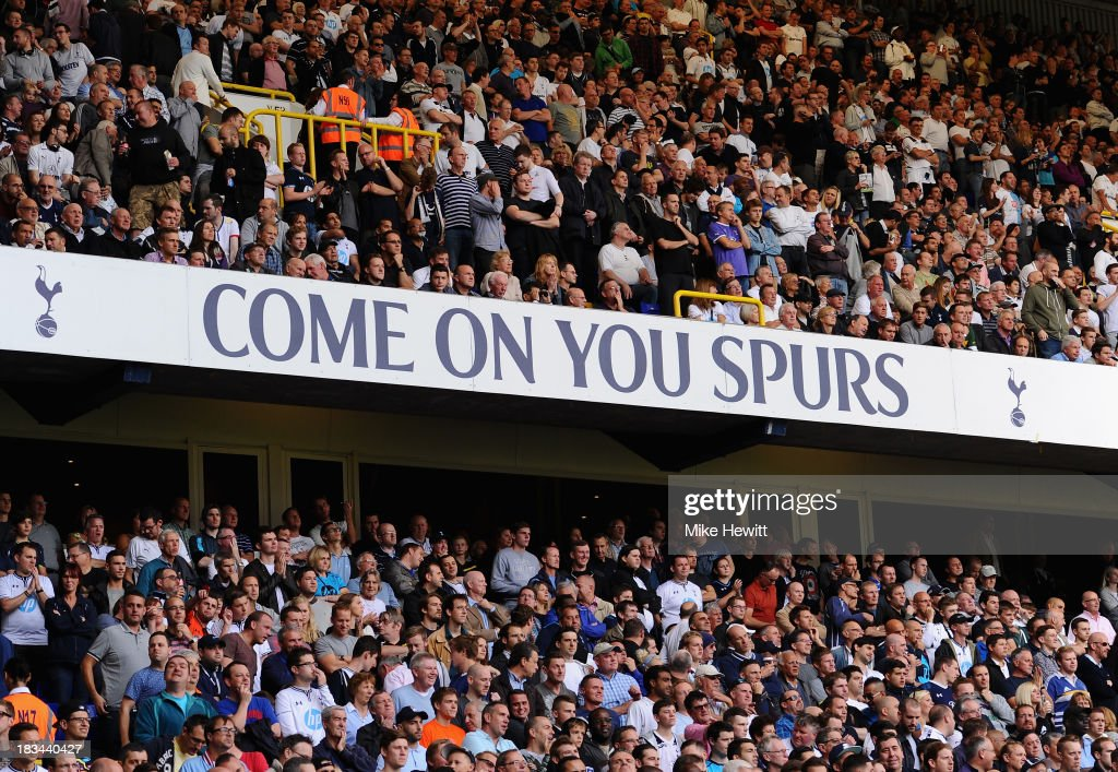 Spectators enjoy the action during the Barclays Premier League match between Tottenham Hotspur and West Ham United at White Hart Lane on October 6, 2013 in London, England.