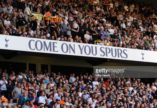 Spectators enjoy the action during the Barclays Premier League match between Tottenham Hotspur and West Ham United at White Hart Lane on October 6...