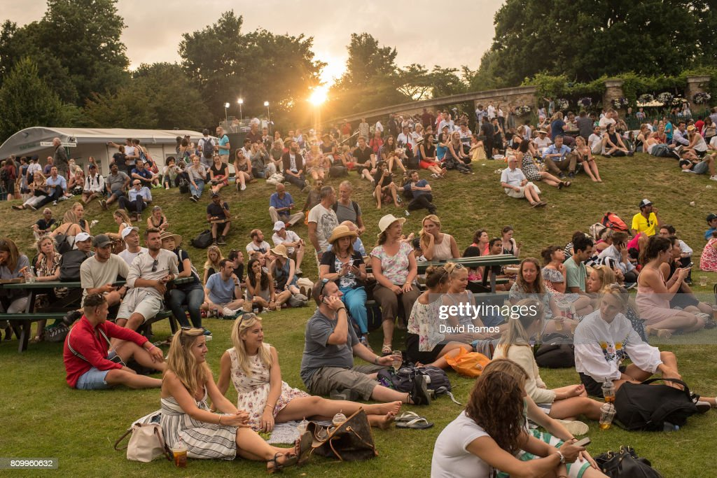 Spectators enjoy the atmosphere at Murray Mound by the end of day four of the Wimbledon Lawn Tennis Championships at the All England Lawn Tennis and Croquet Club on July 6, 2017 in London, England.