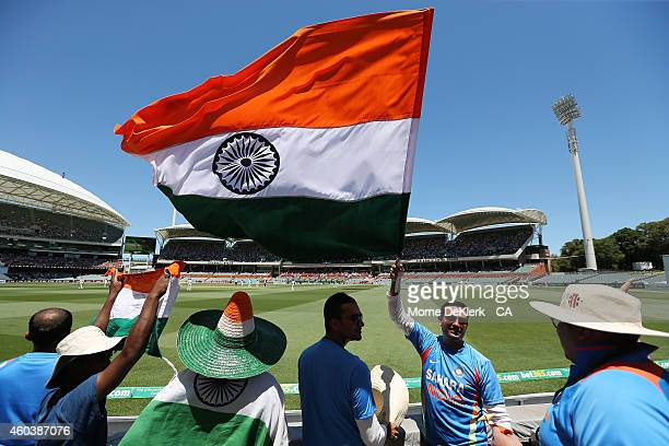 Spectators enjoy the atmosphere during day five of the First Test match between Australia and India at Adelaide Oval on December 13 2014 in Adelaide...