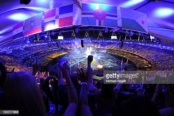 Spectators enjoy the atmosphere during the Closing Ceremony on Day 16 of the London 2012 Olympic Games at Olympic Stadium on August 12, 2012 in...