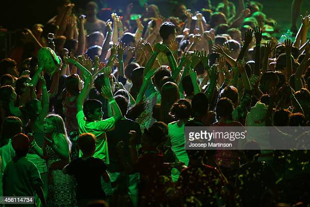 Spectators enjoy the atmosphere during the Nickelodeon Slimefest 2014 matinee show at Sydney Olympic Park Sports Centre on September 26 2014 in...