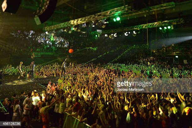 Spectators enjoy the atmosphere during the Nickelodeon Slimefest 2014 evening show at Sydney Olympic Park Sports Centre on September 26 2014 in...