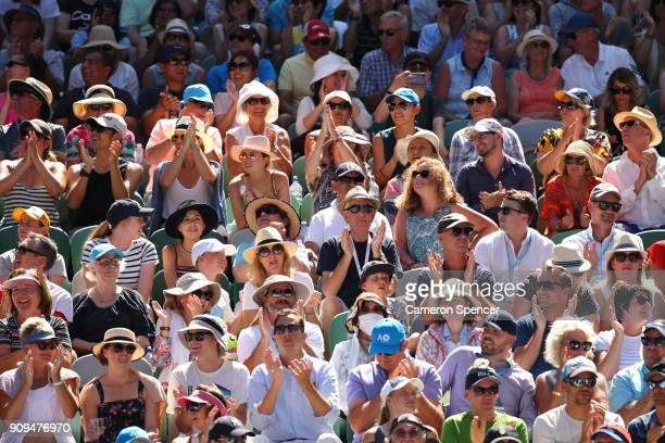 Spectators enjoy the sunshine on Rod Laver Arena as they watch the quarter final between Tennys Sandgren of the United States and Hyeon Chung of...