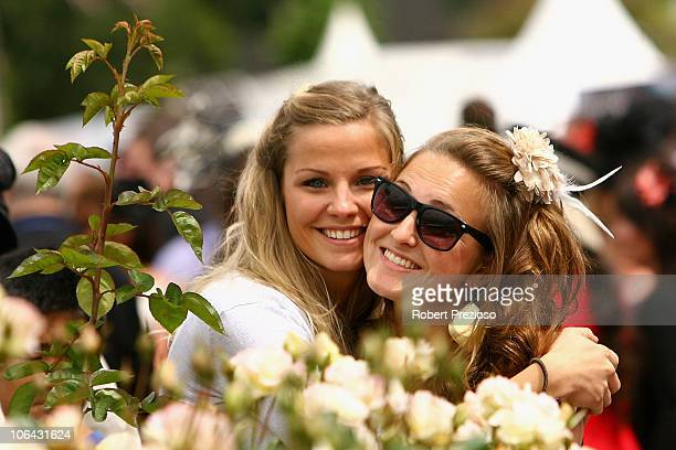 Spectators enjoy themselves during Melbourne Cup Day at Flemington Racecourse on November 2 2010 in Melbourne Australia