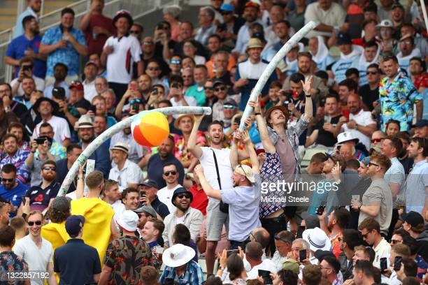 Spectators enjoy themselves with a beer snake in the Hollies stand during day one of the second Test Match between England and New Zealand at...