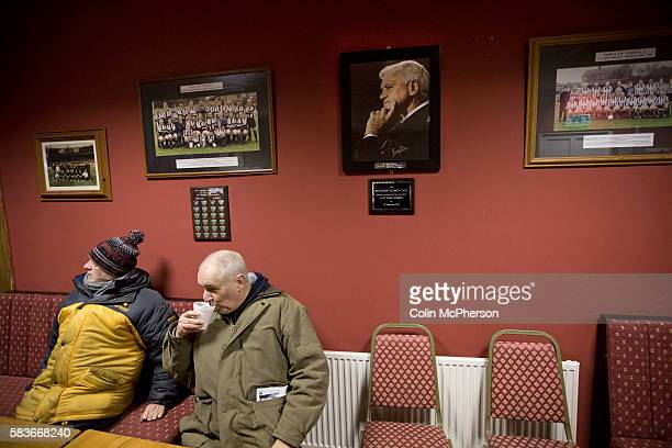 Spectators enjoying halftime refreshments under a photograph of Sir Bobby Robson a former vicepresident of Tow Law Town and after whom the bar is...