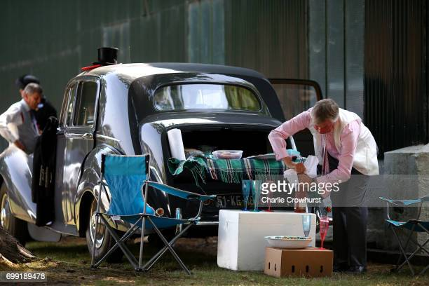 A spectators enjoys a car park picnic during day 2 of Royal Ascot at Ascot Racecourse on June 21 2017 in Ascot England