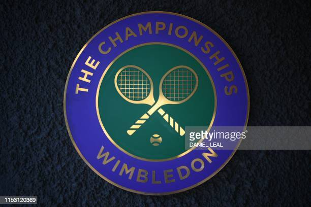 Spectators enter The All England Tennis Club in Wimbledon southwest London on July 1 on the first day of the 2019 Wimbledon Championships tennis...