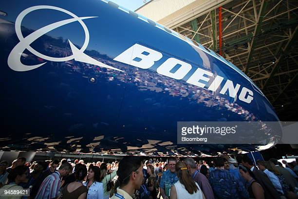 Spectators examine Boeing Co.'s new 787 Dreamliner at the unveiling of the passenger jet at the company's plant in Everett, Washington, on Sunday,...