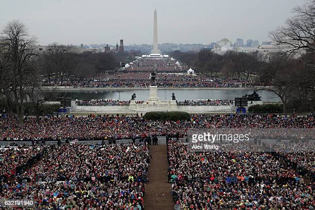 Spectators fill the National Mall in front of the US Capitol on January 20 2017 in Washington DC In today's inauguration ceremony Donald J Trump...
