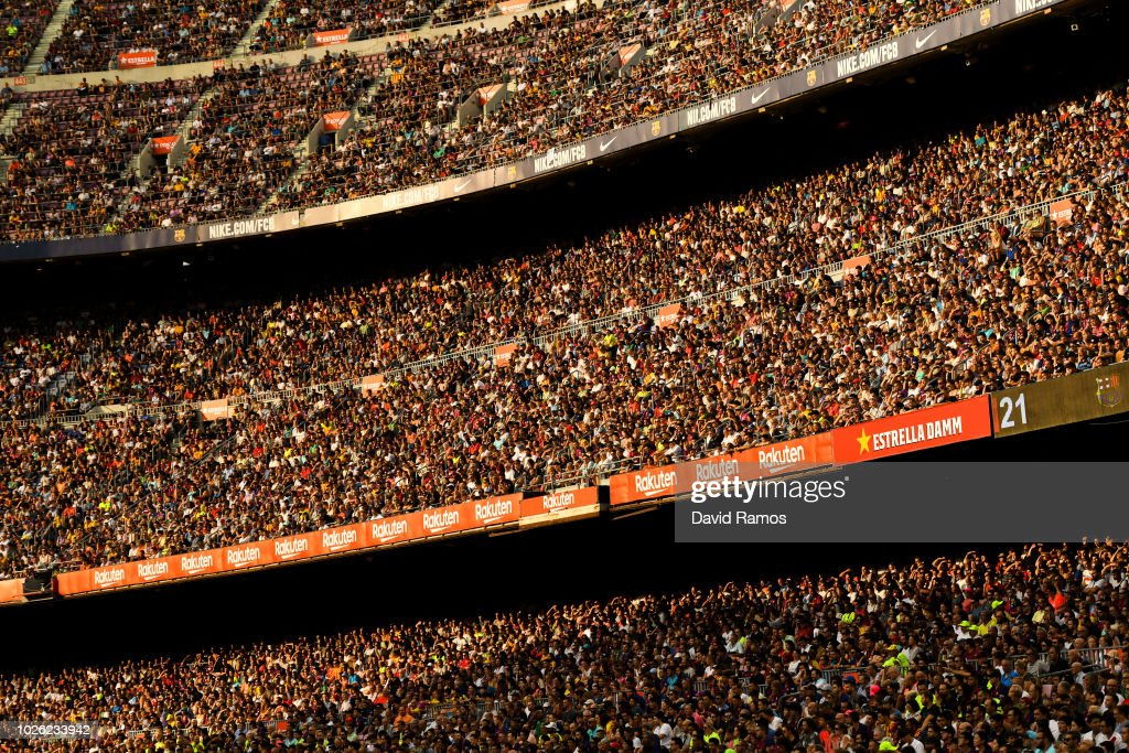 Spectators follow the action from the stands during the La Liga match between FC Barcelona and SD Huesca at Camp Nou on September 2, 2018 in Barcelona, Spain.
