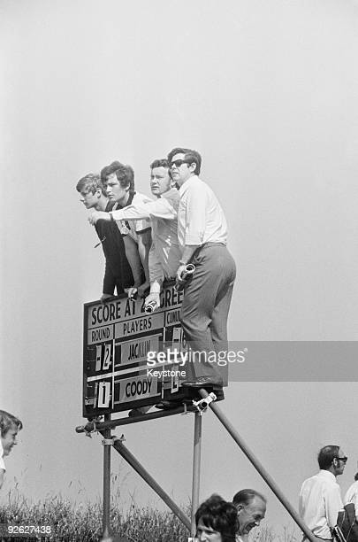 Spectators gain a better view of the green from the top of a scoreboard during the Open Championship at Royal Birkdale 9th July 1971 Britain's Tony...