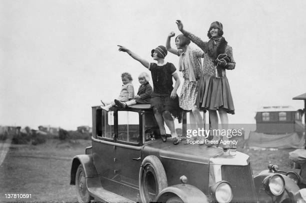 Spectators gain a good vantage point during the Epsom Derby in Surrey, 5th June 1929.
