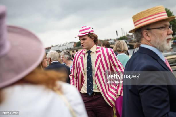 Spectators gather along the bank of the River Thames at the Henley Royal Regatta on June 28 2017 in HenleyonThames England The five day Henley Royal...
