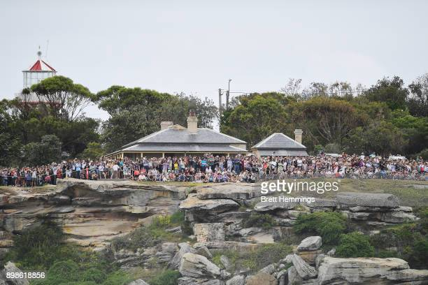 Spectators gather around Kurnell as yachts sail out of Sydney Harbour during the 2017 Sydney to Hobart on December 26 2017 in Sydney Australia