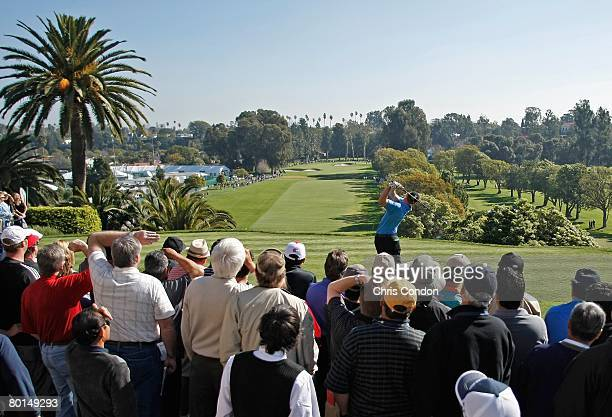 Spectators gather at the first tee to watch play during the third round of the Northern Trust Open held on February 16 2008 at Riviera Country Club...