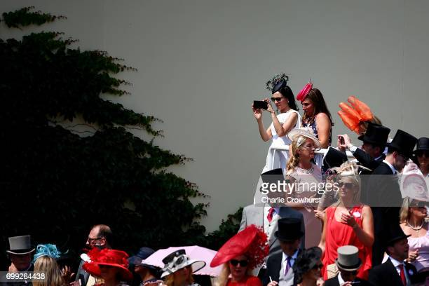 Spectators gather at the parade ring during day 2 of Royal Ascot at Ascot Racecourse on June 21 2017 in Ascot England