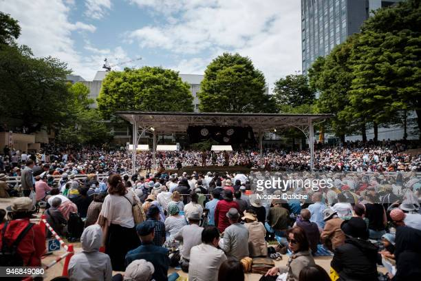 Spectators gather for 'Honozumo' ceremonial on April 16, 2018 in Tokyo, Japan. This annual offering of a Sumo Tournament to the divine at the...