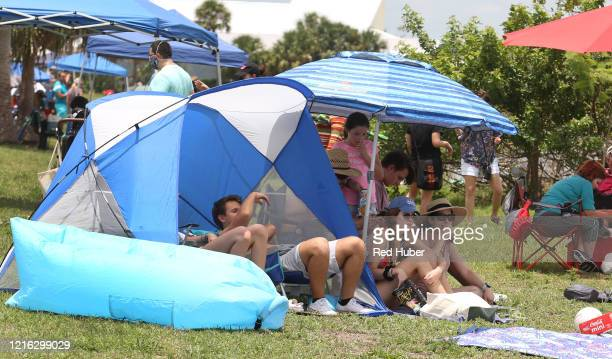 Spectators gather in Marina Park ahead of the launch of a SpaceX Falcon 9 rocket from Cape Canaveral Florida May 30 2020 in Titusville Florida...
