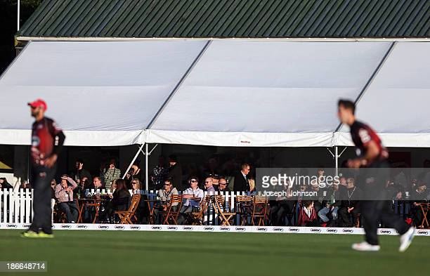 Spectators gather in the temporary corporate tents above at Hagley Oval during the HRV Twenty20 match between Canterbury Wizards and Otago Volts on...