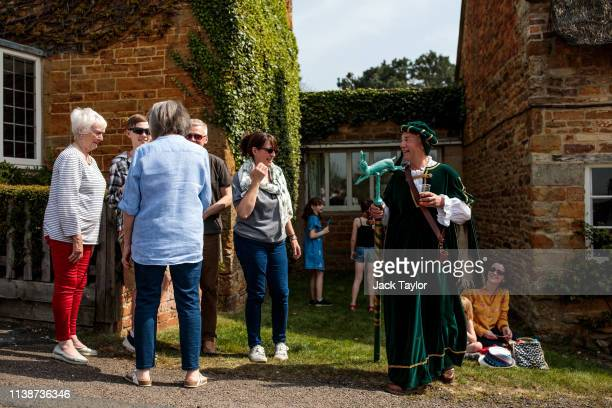 Spectators gather in the town centre before the traditional Easter Monday 'Bottle Kicking' match on April 22 2019 in Hallaton England The Bottle...