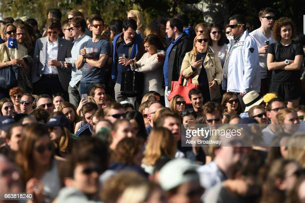 Spectators gather near Hammersmith Bridge prior to The Cancer Research UK Boat Race on April 2 2017 in London England The 163rd annual Cancer...
