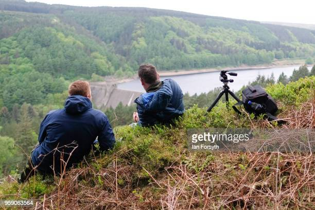 Spectators gather on a hillside above Derwent Dam as they wait for a Lancaster bomber from the Battle of Britain Memorial Flight to fly over the Dam...