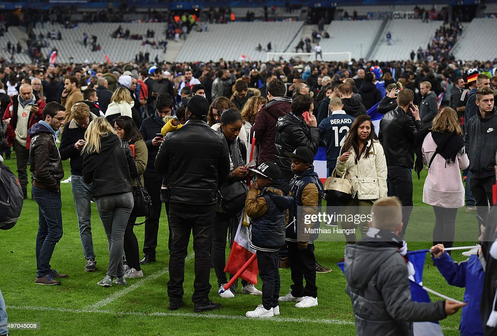 Spectators gather on the pitch of the Stade de France stadium following the International Friendly match between France and Germany at the Stade de France on November 13, 2015 in Paris, France.