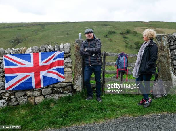 Spectators gather to wait for the arrival of the peloton on the Cote de Park Rash ascent near the village of Kettlewell in the Yorkshire Dales during...