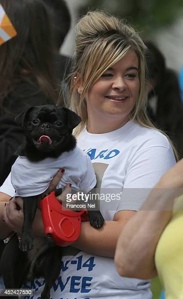 Spectators gather to watch the Queens Baton Relay as it arrives in Glasgow on July 20 2014 in Glasgow ScotlandA total of 400 people will carry the...