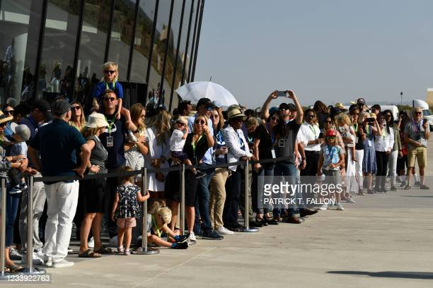 Spectators gather to watch the Virgin Galactic SpaceShipTwo space plane Unity take off at Spaceport America, near Truth and Consequences, New Mexico...