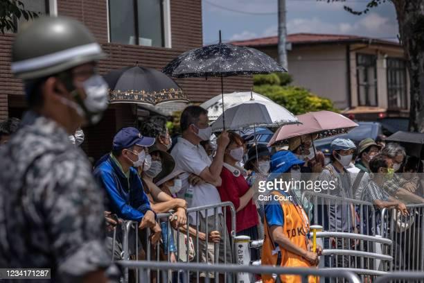Spectators gather to watch the Women's Road Race as it leaves Musashinonomori Park on July 25, 2021 in Tokyo, Japan.