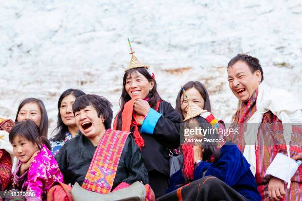 spectators gather to watch traditional performances at the gasa festival - bhutan stock pictures, royalty-free photos & images