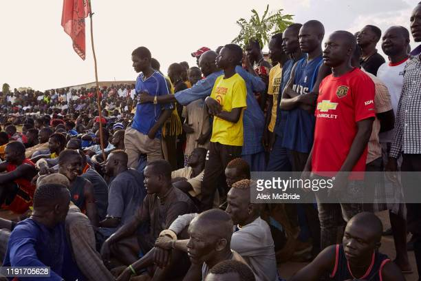 Spectators gather together ahead of a wrestling competitionon December 1 2019 in Shirkat South Sudan Two teams of wrestlers one representing Jonglei...