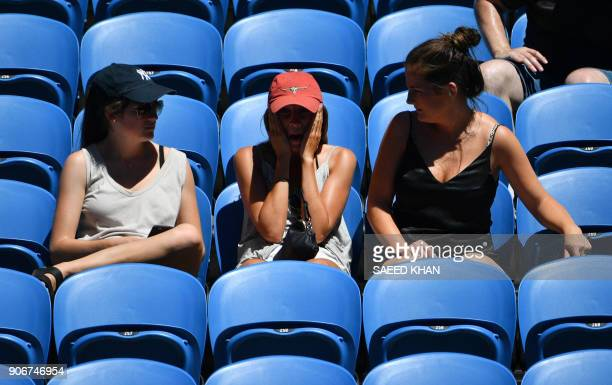 A spectators gestures during the women's singles third round match between Poland's Magda Linette and Czech Republic's Denisa Allertova on day five...