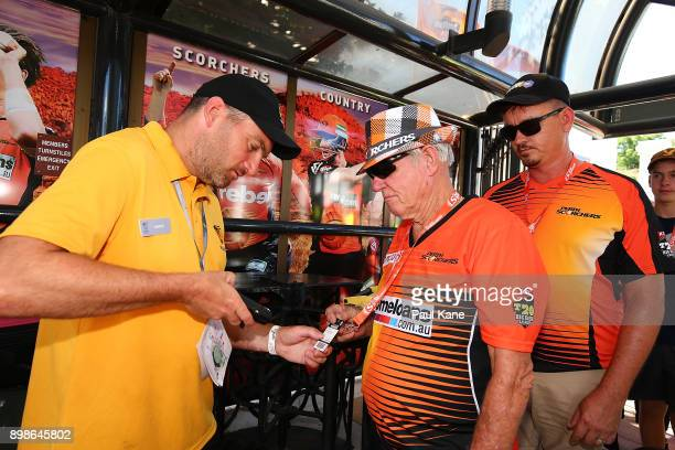 Spectators get their tickets scanned on arrival during the Big Bash League match between the Perth Scorchers and the Melbourne Stars at WACA on...