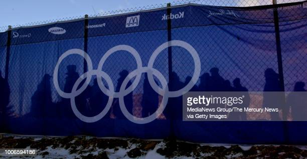 Spectators heading towards the 9am start of the Women's Moguls at the 2002 Winter Olympics at Deer Valley Resort in Park City, Utah can bee sen...