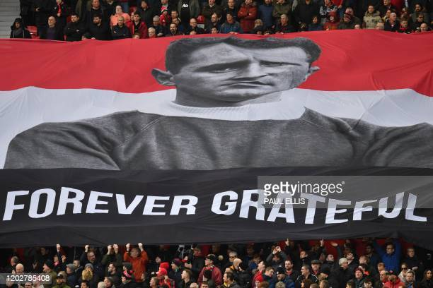Spectators hold aloft a banner in honour of the late Manchester United goalkeeper and Munich Air Disaster hero Harry Gregg before kick off of the...