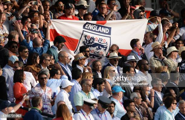 Spectators hold up a flag during the ICC Cricket World Cup Final between New Zealand and England at Lord's on July 14 2019 in London England