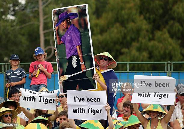 Spectators hold up a poster of Tiger Woods during the first round doubles match between Marinko Matosevic and Bernard Tomic of Australia and Martin...