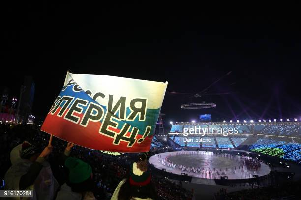 Spectators hold up a Russian sign during the Opening Ceremony of the PyeongChang 2018 Winter Olympic Games at PyeongChang Olympic Stadium on February...