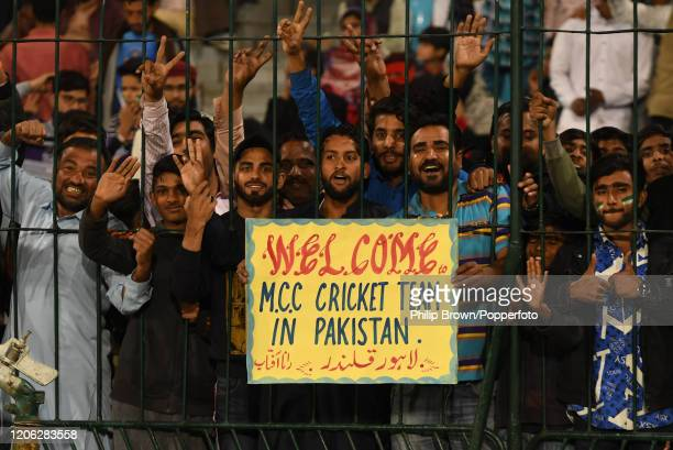 Spectators hold up a sign during the T20 match between MCC and Lahore Qalandars at Gaddafi stadium on February 14, 2020 in Lahore, Pakistan.