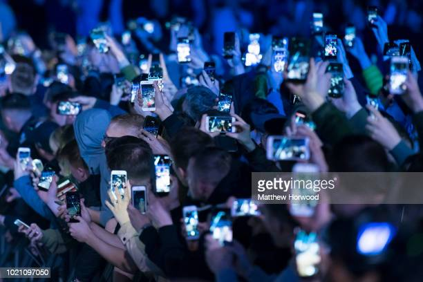 Spectators hold up mobile phones at an event on May 2 2018 in Cardiff United Kingdom