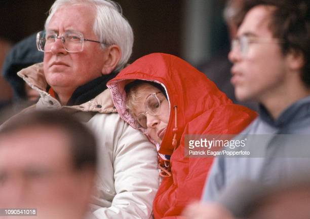 Spectators huddle in the cold watching the Benson and Hedges Cup Quarter Final between Yorkshire and Warwickshire at Headingley Leeds 29th May 1991...