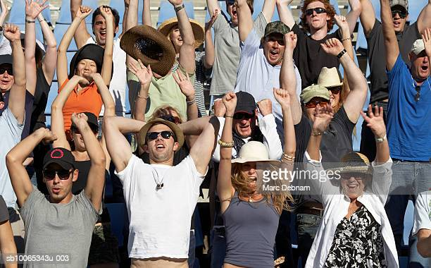 Spectators in crowd celebrating