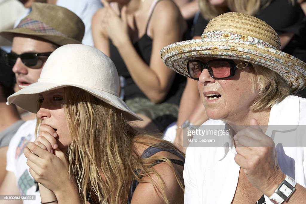 Spectators in crowd, close-up : Foto stock