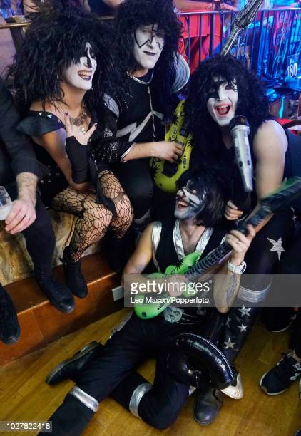 Spectators in fancy dress during a men's first round match on Day Two of the BDO Lakeside World Darts Championships at Lakeside Country Club ion...
