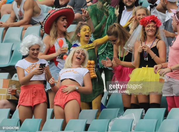 Spectators in fancy dress look on from the stands during the Sydney World Rugby Sevens Series tournament in Sydney on January 26 2018 / AFP PHOTO /...